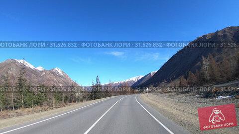 Купить «Driving along mountain asphalt road Chuysky Tract along Kurai Ridge on Altai betveen Kosh-Agach and Kurai intermountain hollows», видеоролик № 31526832, снято 6 июня 2019 г. (c) Serg Zastavkin / Фотобанк Лори
