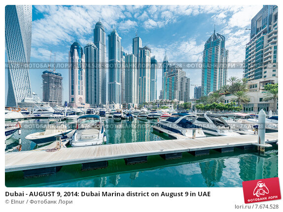 Купить «Dubai - AUGUST 9, 2014: Dubai Marina district on August 9 in UAE», фото № 7674528, снято 9 августа 2014 г. (c) Elnur / Фотобанк Лори