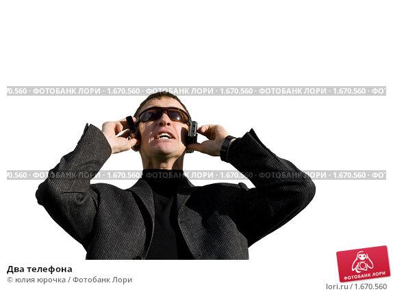Два телефона. Стоковое фото, фотограф юлия юрочка / Фотобанк Лори