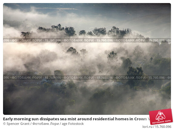 Купить «Early morning sun dissipates sea mist around residential homes in Crown Valley in coastal Laguna Niguel, CA.», фото № 15760096, снято 22 октября 2014 г. (c) age Fotostock / Фотобанк Лори