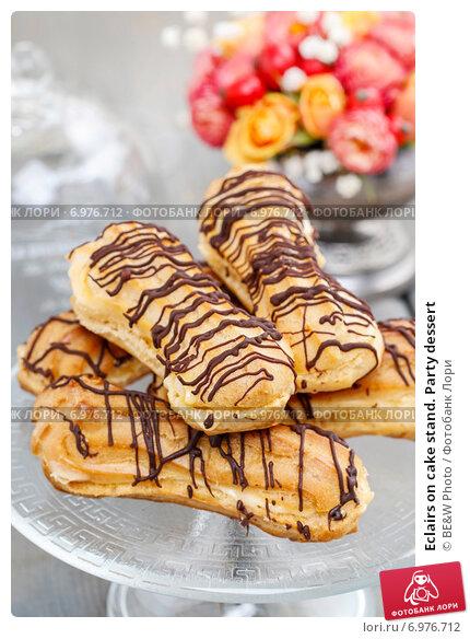 Купить «Eclairs on cake stand. Party dessert», фото № 6976712, снято 25 июня 2019 г. (c) BE&W Photo / Фотобанк Лори