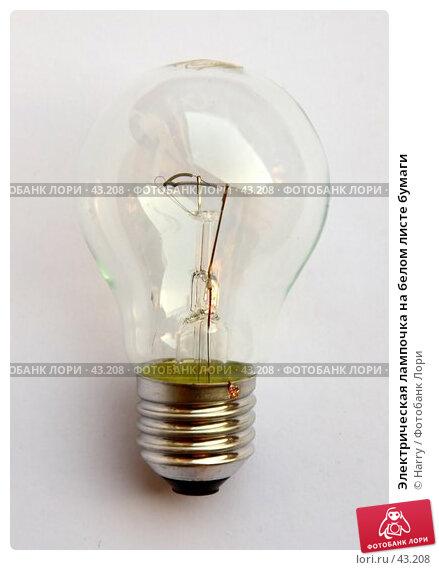 Электрическая лампочка на белом листе бумаги, фото № 43208, снято 1 июня 2005 г. (c) Harry / Фотобанк Лори