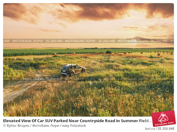 Elevated View Of Car SUV Parked Near Countryside Road In Summer Field... Стоковое фото, фотограф Ryhor Bruyeu / easy Fotostock / Фотобанк Лори