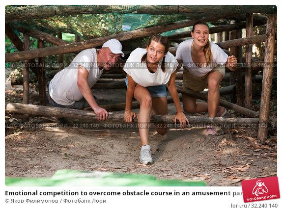 Купить «Emotional competition to overcome obstacle course in an amusement park», фото № 32240140, снято 14 июля 2020 г. (c) Яков Филимонов / Фотобанк Лори