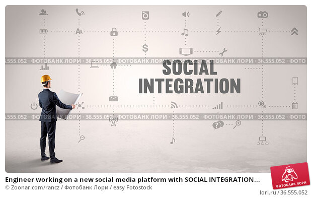 Engineer working on a new social media platform with SOCIAL INTEGRATION... Стоковое фото, фотограф Zoonar.com/rancz / easy Fotostock / Фотобанк Лори