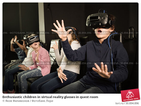 Купить «Enthusiastic children in virtual reality glasses in quest room», фото № 30894896, снято 21 октября 2017 г. (c) Яков Филимонов / Фотобанк Лори
