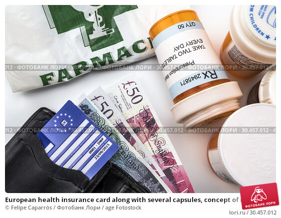 European health insurance card along with several capsules, concept of medical increase in the crisis of the brexit, conceptual image, horizontal composition. Стоковое фото, фотограф Felipe Caparrós / age Fotostock / Фотобанк Лори