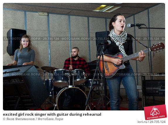 Купить «excited girl rock singer with guitar during rehearsal», фото № 29735124, снято 26 октября 2018 г. (c) Яков Филимонов / Фотобанк Лори