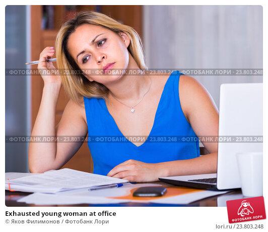 Купить «Exhausted young woman at office», фото № 23803248, снято 22 апреля 2019 г. (c) Яков Филимонов / Фотобанк Лори