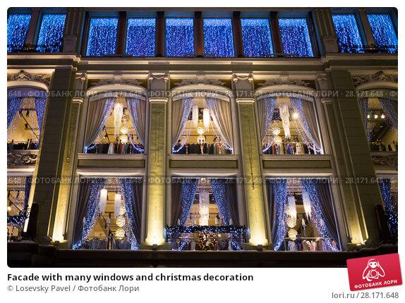 Купить «Facade with many windows and christmas decoration», фото № 28171648, снято 1 января 2015 г. (c) Losevsky Pavel / Фотобанк Лори