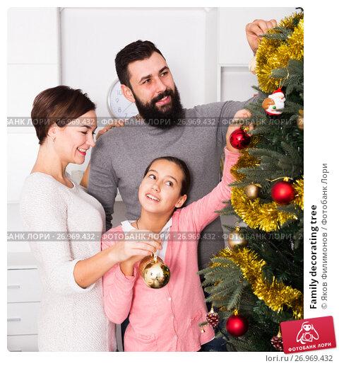 Купить «Family decorating tree», фото № 26969432, снято 19 января 2018 г. (c) Яков Филимонов / Фотобанк Лори
