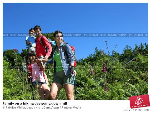 Купить «Family on a hiking day going down hill », фото № 11825820, снято 23 января 2019 г. (c) PantherMedia / Фотобанк Лори