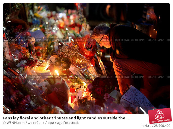 Купить «Fans lay floral and other tributes and light candles outside the home of singer George Michael in memory of the popular performer. His Range Rover has...», фото № 28700492, снято 28 декабря 2016 г. (c) age Fotostock / Фотобанк Лори