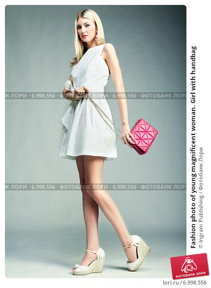 Купить «Fashion photo of young magnificent woman. Girl with handbag», фото № 6998556, снято 31 мая 2014 г. (c) Ingram Publishing / Фотобанк Лори