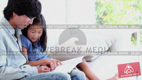 Купить «Father doing his daughters homework with her», видеоролик № 29681900, снято 25 ноября 2011 г. (c) Wavebreak Media / Фотобанк Лори