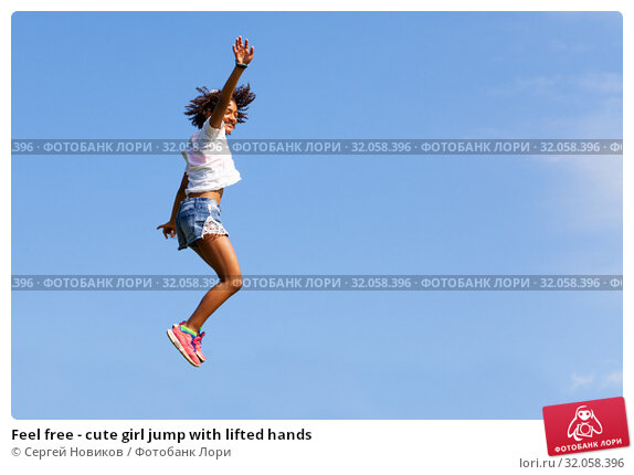Feel free - cute girl jump with lifted hands. Стоковое фото, фотограф Сергей Новиков / Фотобанк Лори