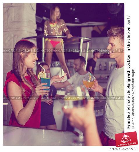 Купить «Female and male clubbing with cocktail in the club on party», фото № 28248512, снято 28 августа 2017 г. (c) Яков Филимонов / Фотобанк Лори