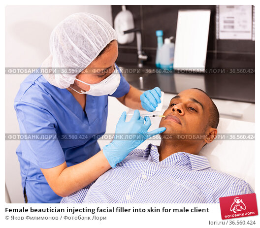 Female beautician injecting facial filler into skin for male client. Стоковое фото, фотограф Яков Филимонов / Фотобанк Лори