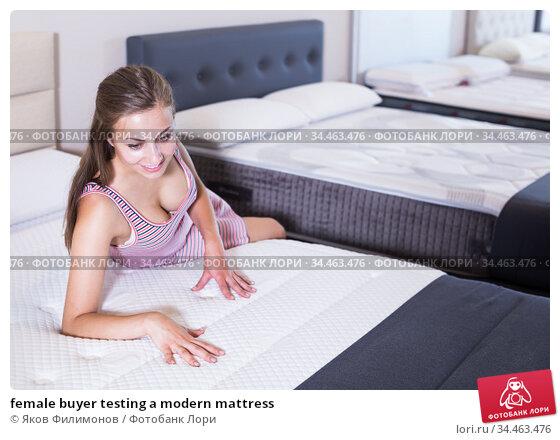 female buyer testing a modern mattress. Стоковое фото, фотограф Яков Филимонов / Фотобанк Лори