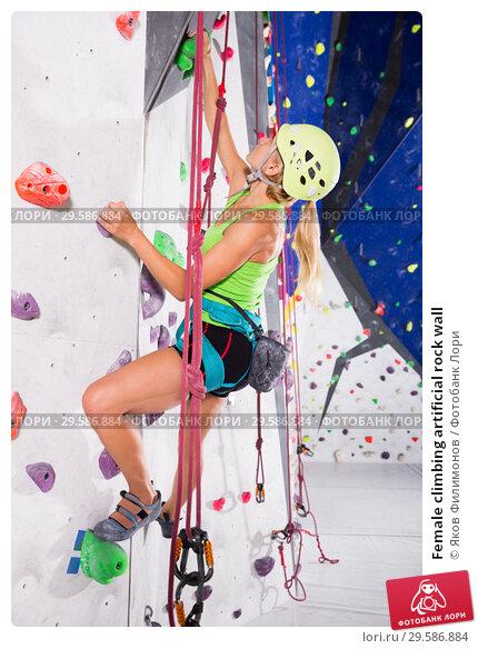 Купить «Female climbing artificial rock wall», фото № 29586884, снято 22 января 2019 г. (c) Яков Филимонов / Фотобанк Лори