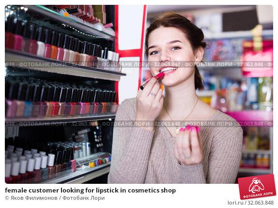 female customer looking for lipstick in cosmetics shop. Стоковое фото, фотограф Яков Филимонов / Фотобанк Лори
