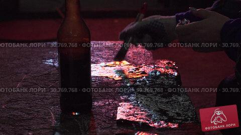 Купить «Female Decorator Applies Foil With A Special Tool», видеоролик № 30769768, снято 16 июля 2020 г. (c) Pavel Biryukov / Фотобанк Лори