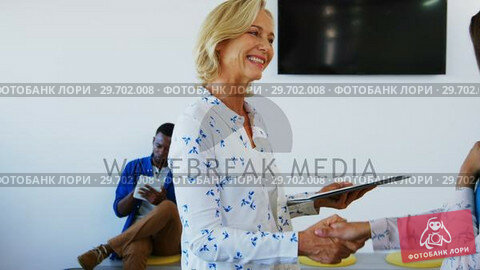Купить «Female executives shaking hands while interacting with each other», видеоролик № 29702008, снято 4 марта 2017 г. (c) Wavebreak Media / Фотобанк Лори