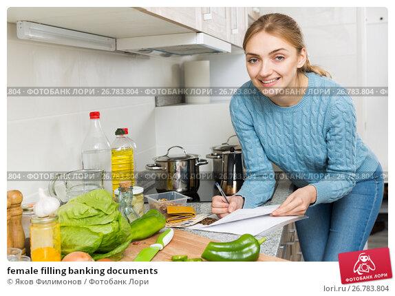 female filling banking documents, фото № 26783804, снято 26 сентября 2017 г. (c) Яков Филимонов / Фотобанк Лори