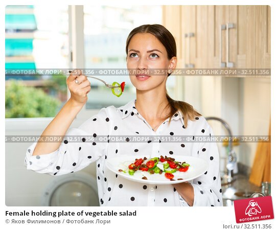 Female holding plate of vegetable salad. Стоковое фото, фотограф Яков Филимонов / Фотобанк Лори