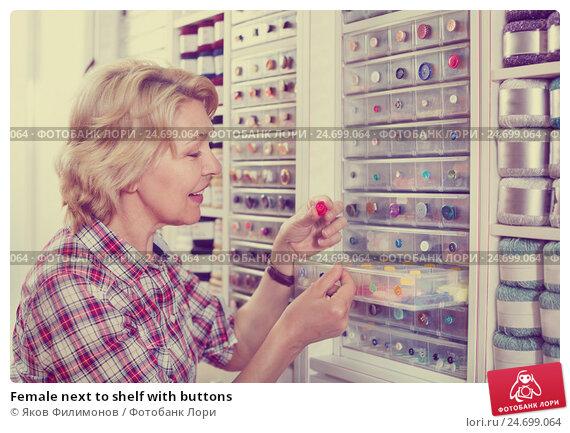 Купить «Female next to shelf with buttons», фото № 24699064, снято 21 мая 2019 г. (c) Яков Филимонов / Фотобанк Лори