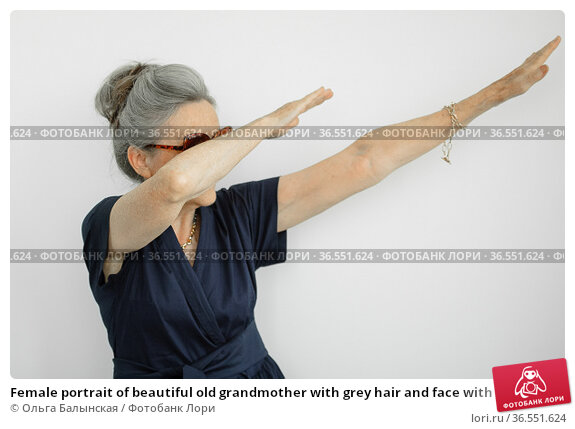 Female portrait of beautiful old grandmother with grey hair and face with wrinkles making dab on white background, mothers day, happy retirement. Стоковое фото, фотограф Ольга Балынская / Фотобанк Лори