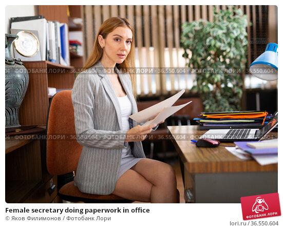 Female secretary doing paperwork in office. Стоковое фото, фотограф Яков Филимонов / Фотобанк Лори
