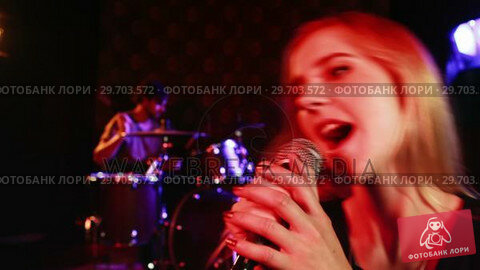 Купить «Female singer singing into a microphone 4k», видеоролик № 29703572, снято 7 марта 2017 г. (c) Wavebreak Media / Фотобанк Лори