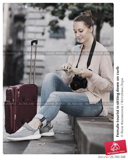 Купить «Female tourist is sitting down on curb», фото № 26760348, снято 4 мая 2017 г. (c) Яков Филимонов / Фотобанк Лори
