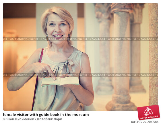 Купить «female visitor with guide book in the museum», фото № 27204584, снято 7 октября 2017 г. (c) Яков Филимонов / Фотобанк Лори