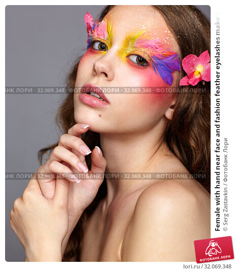Female with hand near face and fashion feather eyelashes make-up. Стоковое фото, фотограф Serg Zastavkin / Фотобанк Лори