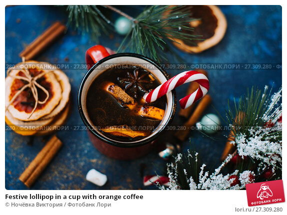 Купить «Festive lollipop in a cup with orange coffee», фото № 27309280, снято 10 декабря 2017 г. (c) Ночёвка Виктория / Фотобанк Лори