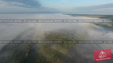 Купить «Flight from above over dense fog at dawn», видеоролик № 27526364, снято 18 января 2018 г. (c) Михаил Коханчиков / Фотобанк Лори