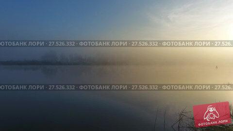 Купить «Flight over surface of river in fog at dawn», видеоролик № 27526332, снято 18 января 2018 г. (c) Михаил Коханчиков / Фотобанк Лори