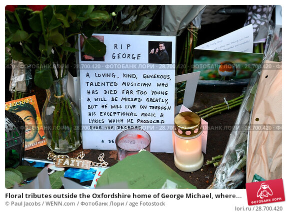 Купить «Floral tributes outside the Oxfordshire home of George Michael, where he was found dead on Christmas Day at Goring-on-Thames Featuring: Atmosphere Where...», фото № 28700420, снято 28 декабря 2016 г. (c) age Fotostock / Фотобанк Лори