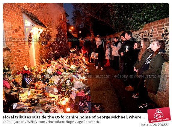 Купить «Floral tributes outside the Oxfordshire home of George Michael, where he was found dead on Christmas Day at Goring-on-Thames Featuring: Atmosphere Where...», фото № 28700584, снято 28 декабря 2016 г. (c) age Fotostock / Фотобанк Лори