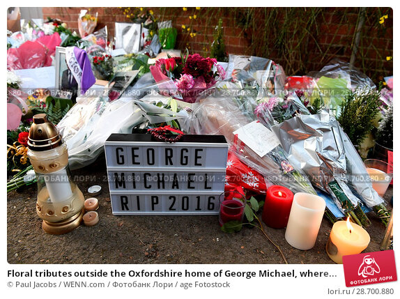 Купить «Floral tributes outside the Oxfordshire home of George Michael, where he was found dead on Christmas Day at Goring-on-Thames Featuring: Atmosphere Where...», фото № 28700880, снято 28 декабря 2016 г. (c) age Fotostock / Фотобанк Лори