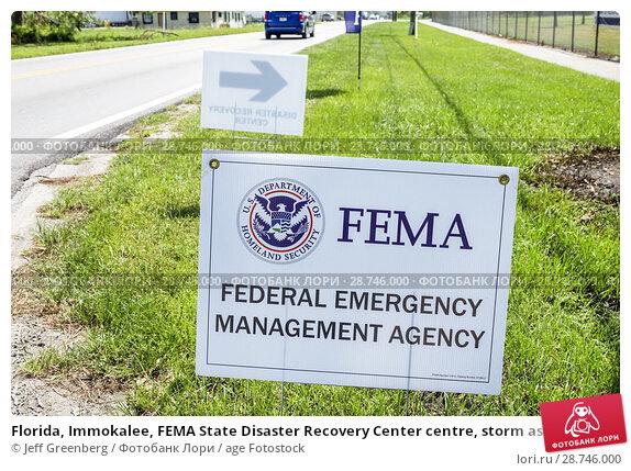 Купить «Florida, Immokalee, FEMA State Disaster Recovery Center centre, storm assistance relief, roadside sign,», фото № 28746000, снято 26 сентября 2017 г. (c) age Fotostock / Фотобанк Лори