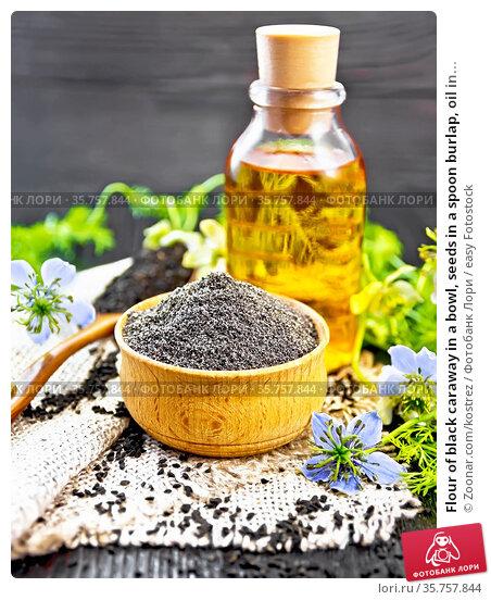 Flour of black caraway in a bowl, seeds in a spoon burlap, oil in... Стоковое фото, фотограф Zoonar.com/kostrez / easy Fotostock / Фотобанк Лори