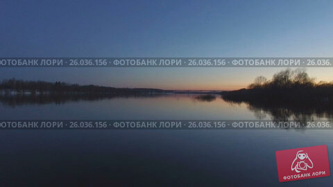 Купить «Flying over the beautiful river in high water», видеоролик № 26036156, снято 8 апреля 2017 г. (c) Никита Буйда / Фотобанк Лори
