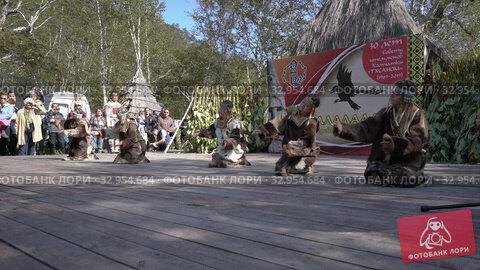 Folklore ensemble of indigenous people of Kamchatka dancing in traditional clothing during Itelmens national ritual festival thanksgiving nature Alhalalalay. Kamchatka Peninsula (2019 год). Редакционное видео, видеограф А. А. Пирагис / Фотобанк Лори