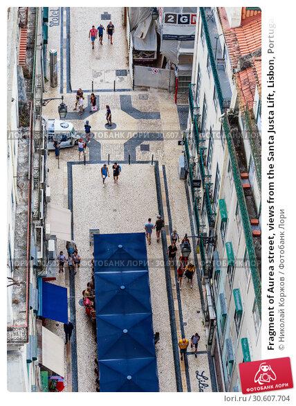 Купить «Fragment of Aurea street, views from the Santa Justa Lift, Lisbon, Portugal», фото № 30607704, снято 15 июля 2018 г. (c) Николай Коржов / Фотобанк Лори
