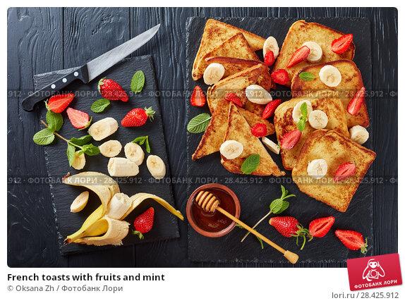 Купить «French toasts with fruits and mint», фото № 28425912, снято 9 мая 2018 г. (c) Oksana Zh / Фотобанк Лори