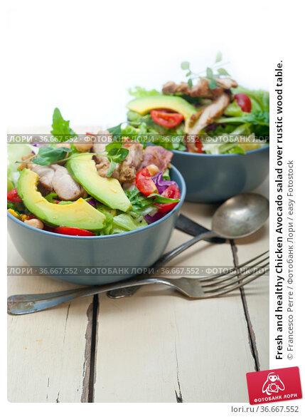 Fresh and healthy Chicken Avocado salad over rustic wood table. Стоковое фото, фотограф Francesco Perre / easy Fotostock / Фотобанк Лори