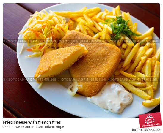 Купить «Fried cheese with french fries», фото № 33538368, снято 14 июля 2020 г. (c) Яков Филимонов / Фотобанк Лори